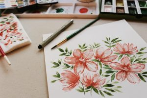 painting of red petaled flowers