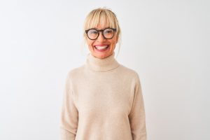middle aged woman with glasses smiling