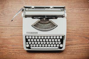 typewriter on a wood grain background