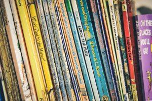 various children's book on shelf