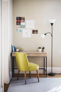 home office setup with yellow desk chair