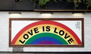 Love is Love written across brick wall