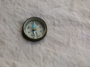 photo-of-a-compass-pointing-north