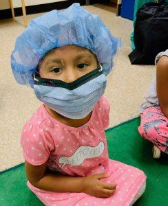 Antonette's daughter in scrubs